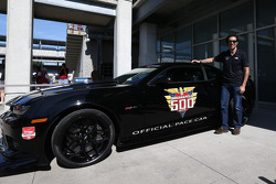 Dario Franchitti poses with the pace car