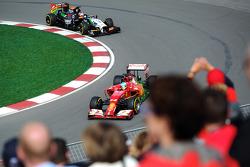 Fernando Alonso, Ferrari F14-T leads Nico Hulkenberg, Sahara Force India F1 VJM07