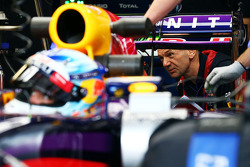 Adrian Newey, Red Bull Racing Chief Technical Officer looks at the Red Bull Racing RB10 of Sebastian Vettel, Red Bull Racing RB10