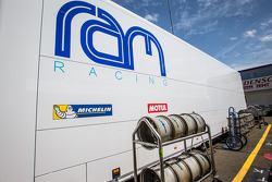 Krohn Racing paddock area with RAM Racing transporter