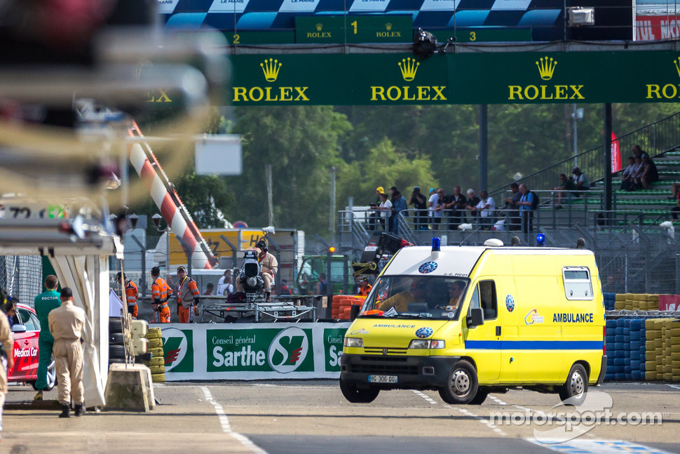 Ambulance carrying Loic Duval after his crash during Wednesday practice