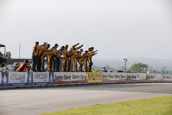 Brendan Gaughan's crew celebrates the win
