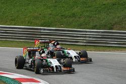 Sergio Perez, Sahara Force India F1 VJM07 passes team mate Nico Hulkenberg, Sahara Force India F1 VJM07