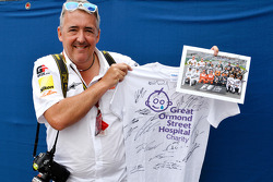 Mark Sutton of Sutton Images poses with signed memorabilia for the Great Ormond Street Hospital charity auction