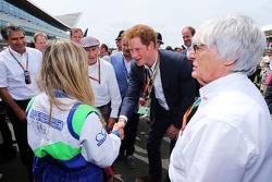Pasquale Lattuneddu, of the FOM; Jackie Stewart, HRH Prince Harry, on the grid