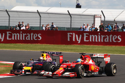Fernando Alonso, Ferrari F14-T and Sebastian Vettel, Red Bull Racing RB10 battle for position