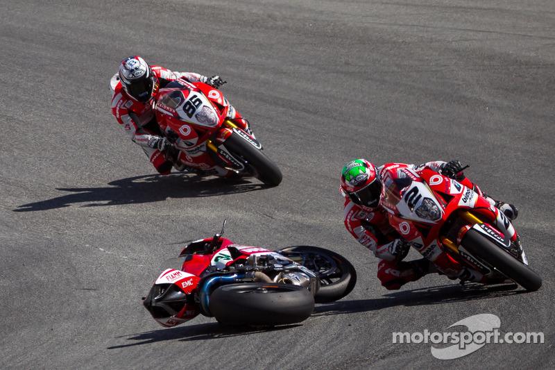 Riders dodge the bike of Davide Giugliano