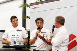Patrick Dempsey, Actor, taking part in the Porsche Supercup race, with Martin Brundle, Sky Sports Commentator