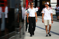 Jenson Button, McLaren with Adrian Sutil, Sauber