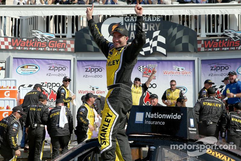 Marcos Ambrose celebrates