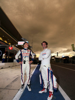 Mike Conway and Nicolas Lapierre look at the intense skies over COTA