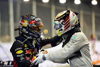 2nd place Sebastian Vettel, Red Bull Racing celebrates with race winner Lewis Hamilton, Mercedes AMG F1 in parc ferme