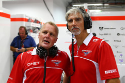 Johnny Herbert, Sky Sports F1 Presenter and Damon Hill, Sky Sports Presenter work with the Marussia F1 Team mechanics