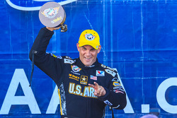 Tony Schumacher celebrates victory at Dallas for delayed Charlotte race