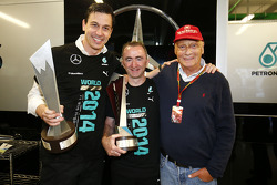 (L to R): Toto Wolff, Mercedes AMG F1 Shareholder and Executive Director; Paddy Lowe, Mercedes AMG F1 Executive Director and Niki Lauda, Mercedes Non-Executive Chairman celebrate winning the 2014 Constructors Championship with the team