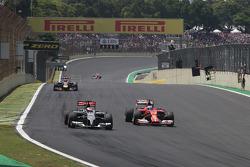 Adrian Sutil, Sauber F1 Team and Kimi Raikkonen, Scuderia Ferrari