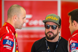 Gianmaria Bruni and James Calado talking to Fernando Alonso