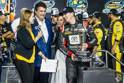 Championship victory lane: NASCAR Camping World Truck Series 2014 champion owner Kyle Busch with Mike Helton