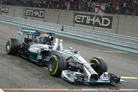 Lewis Hamilton, Mercedes AMG F1 crosses the finish line to win and take 2014 World Championship