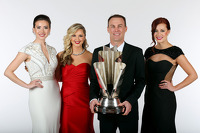 Miss Sprint Cups Madison Martin, Kim Coon, and Julianna White pose for a portrait with NASCAR Sprint Cup Series Champion Kevin Harvick