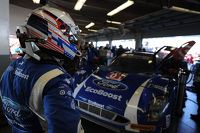 Joey Hand watches as his car is repaired