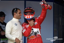 Pole winner Rubens Barrichello celebrates with Juan Pablo Montoya
