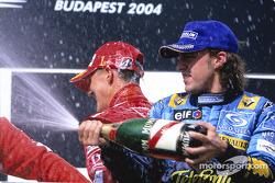 Podium: champagne Michael Schumacher and Fernando Alonso