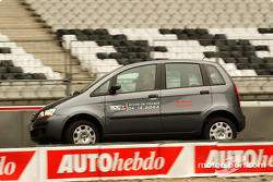 Michael Schumacher drives a Fiat Idea around the track