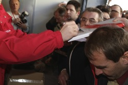 Ralf Schumacher signs merchandise for fans