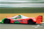 #5 Mazdaspeed Mazda MXR-01 blur at the Dunlop chicane: Volker Weidler, Johnny Herbert, Bertrand Gachot, Maurizio Sandro Sala