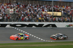 Jeff Gordon takes the checkered flag ahead of Kurt Busch