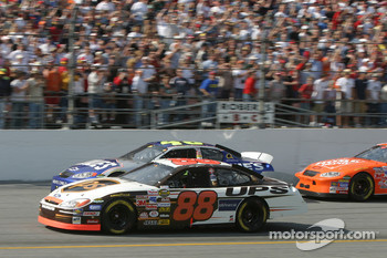 Green flag: Dale Jarrett and Jimmie Johnson battle for the lead