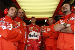 Michael Schumacher watches the end of the qualifying session