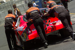Team Cingular push the #31 into inspection