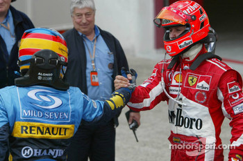 Fernando Alonso and Michael Schumacher congratulate each other