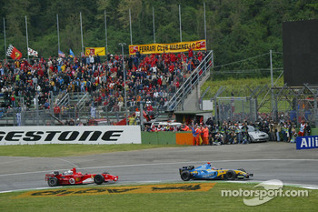 Fernando Alonso and Michael Schumacher battle