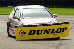 #10 Synchro Motorsport Honda Civic of James Kaye picks up some debris