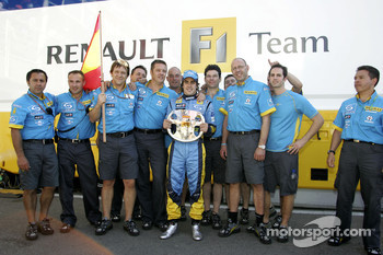 Fernando Alonso celebrates second place finish with Renault F1 team members