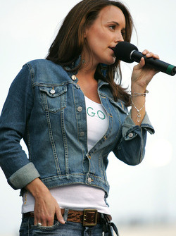 Courtney Jaye sings the National Anthem prior to the NASCAR Nextel Cup Chevy American Revolution 400