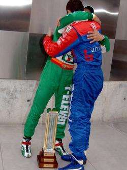 Pole winner Tony Kanaan congratulated by Dario Franchitti