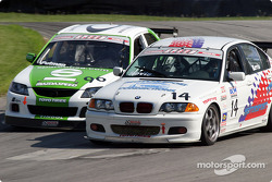 Billy Revis (#14 BMW 325Ci) and Charlie Putman (#96 Mazda Protegé ES)