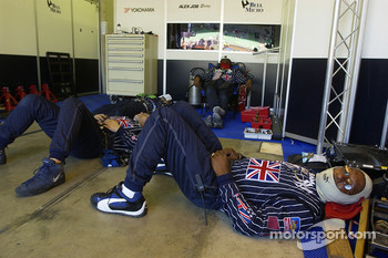 Alex Job Racing crew members take a nap