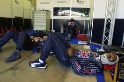 Alex Job Racing crew members take a nap
