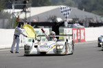 Tom Kristensen celebrates as he takes the checkered flag