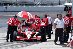 The Target crew swarms over Briscoe's car