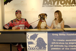 NASCAR pets calendar press conference: Greg Biffle with his dog Foster and Nicole Lunders