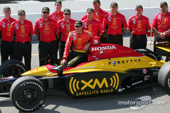 Pole winner Bryan Herta celebrates with his team