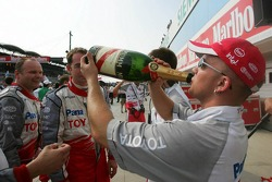 Toyota team members enjoy champagne