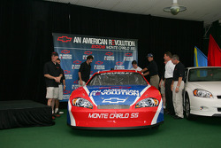 Kevin Harvick, Scott Briggs, Boris Said, Michael Waltrip, Bobby Labonte and Joe Nemechek beside the 2006 Monte Carlo SS NASCAR race car