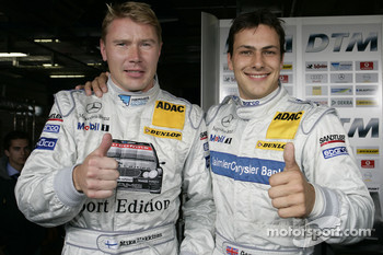 Pole winner Gary Paffett celebrates with Mika Hakkinen